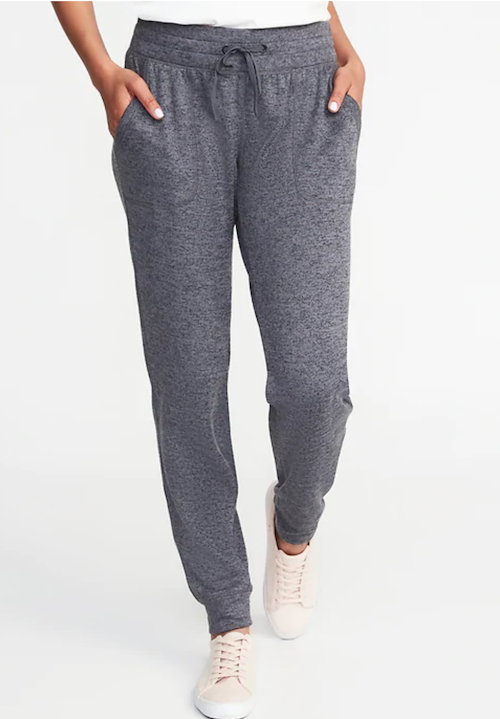 Old navy grey joggers with deep pockets modeled by a person wearing really cute pink sneakers