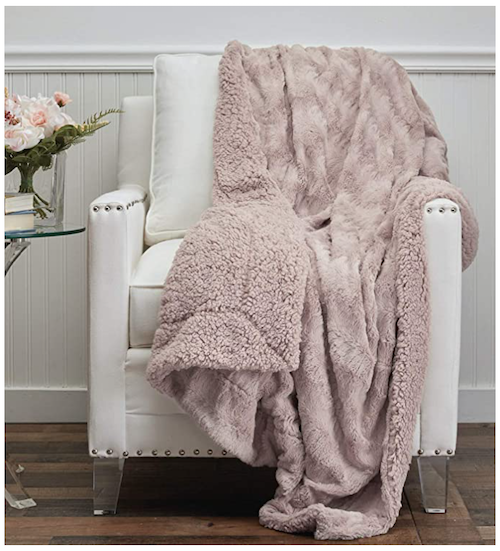 Connecticut Home Company Faux Fur Throw in light pink on a white leather chair