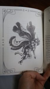 Photo of a page from the book, depicting a faerie from Chernobyl