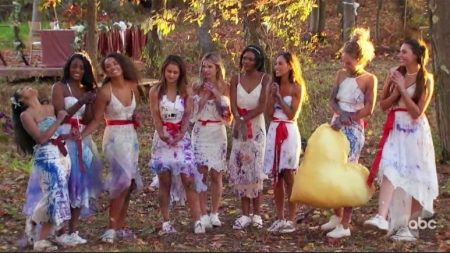 The red team is in wedding dresses, covered in paint.