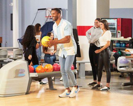 The women go bowling with Matt