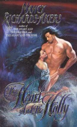 The Heart and the Holly by Nancy Richards Akers. A very old school cover. A woman is embracing a man around the waist on some dangerous seaside rocks, but the man is not wearing any clothes.