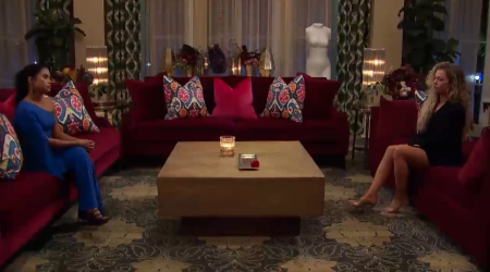 Jessenia and MJ sit on opposite couches and glare at each other