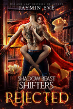 Shadow Beast Shifters Rejected by Jaymin Eve. A man and woman are both on fire in a study or library. She is wrapped around him, legs around his waist and his arms are outstretched to the sides.