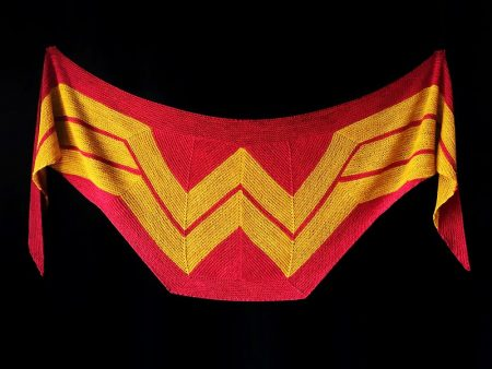 A red shawl with wonder woman's logo in the center
