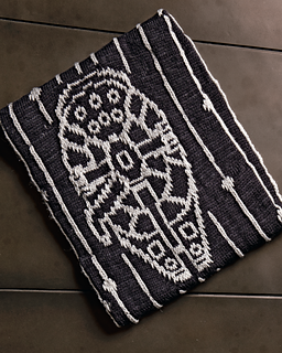 A black and white cowl with the millennium falcon in the pattern