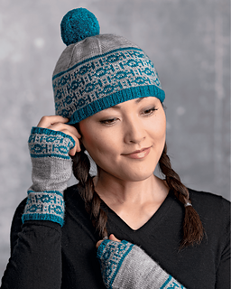 A woman wears a winter hat and fingerless mitts that have a pattern of tie fighters around the edges