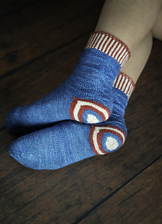 A pair of blue socks with the pattern for Captain America's shield in the heel