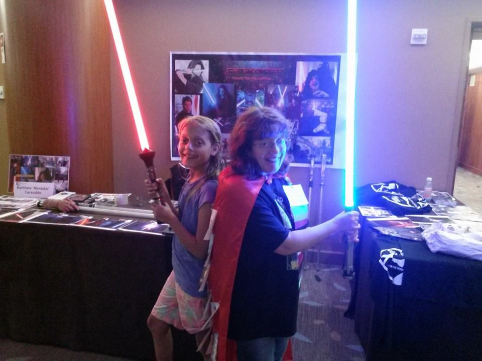 Carrie and young friend wielding sabers