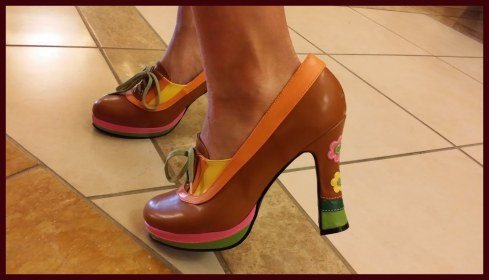 Marie Sexton's shoes, brown and yellow and pink with flowers on the heel