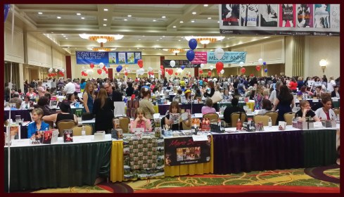 Got book fair? Crowded ballroom with balloons and many many people