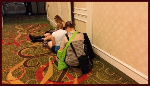 Women sitting in the hall reading books
