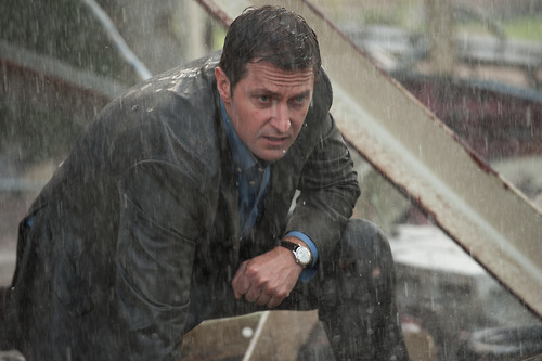Richard Armitage, soaking wet in a rainstorm