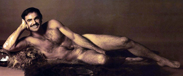 Burt Reynolds burt-naked laying on a bearskin rug