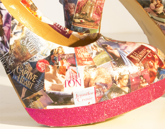 A close up of the toe of one shoe showing bertrice small, tessa dare, and other novels on the surface of the shoe