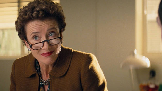 Emma Thompson as PL Travers - fierce curly hair, big glasses, looks unpleasant