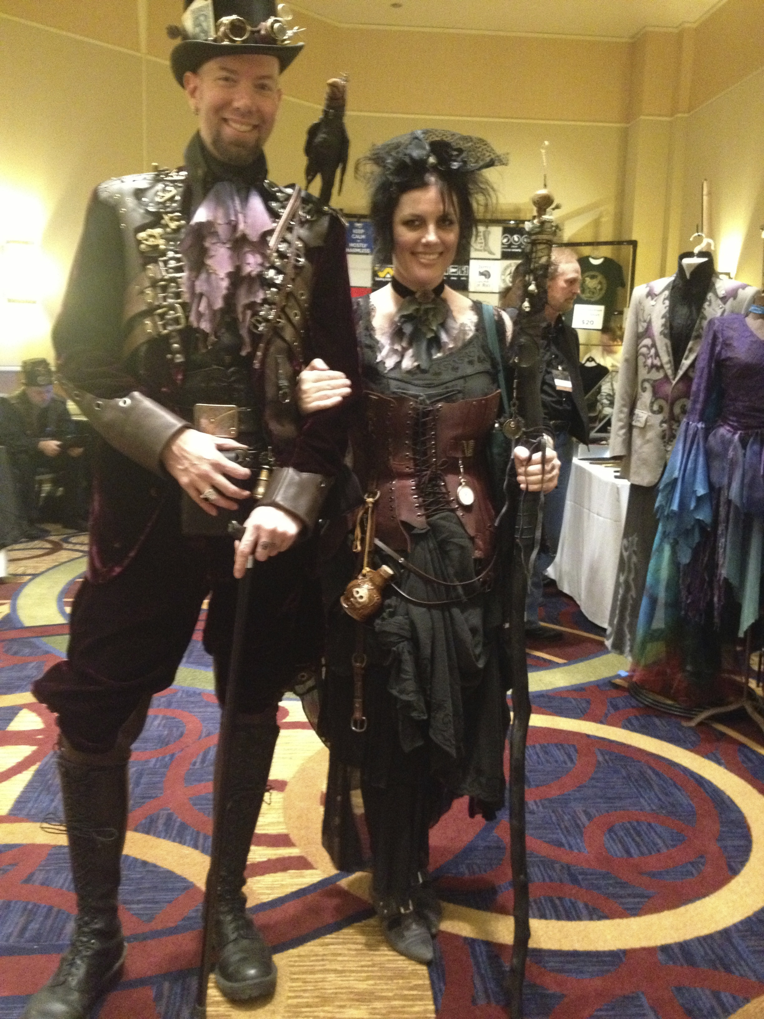 Couple dressed in steampunk style with a crow on one shoulder