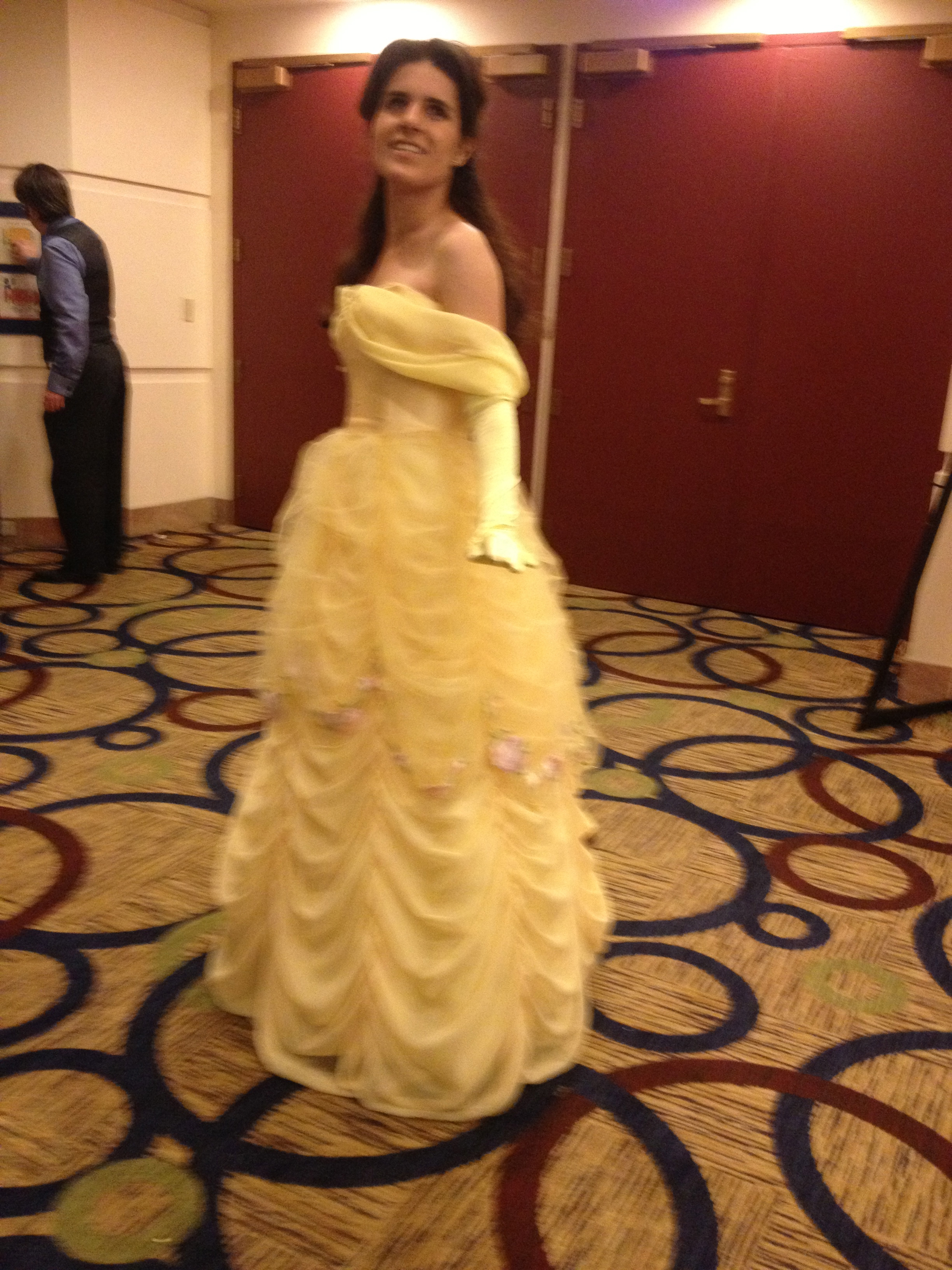 Woman dressed as Belle from Beauty and the Beast