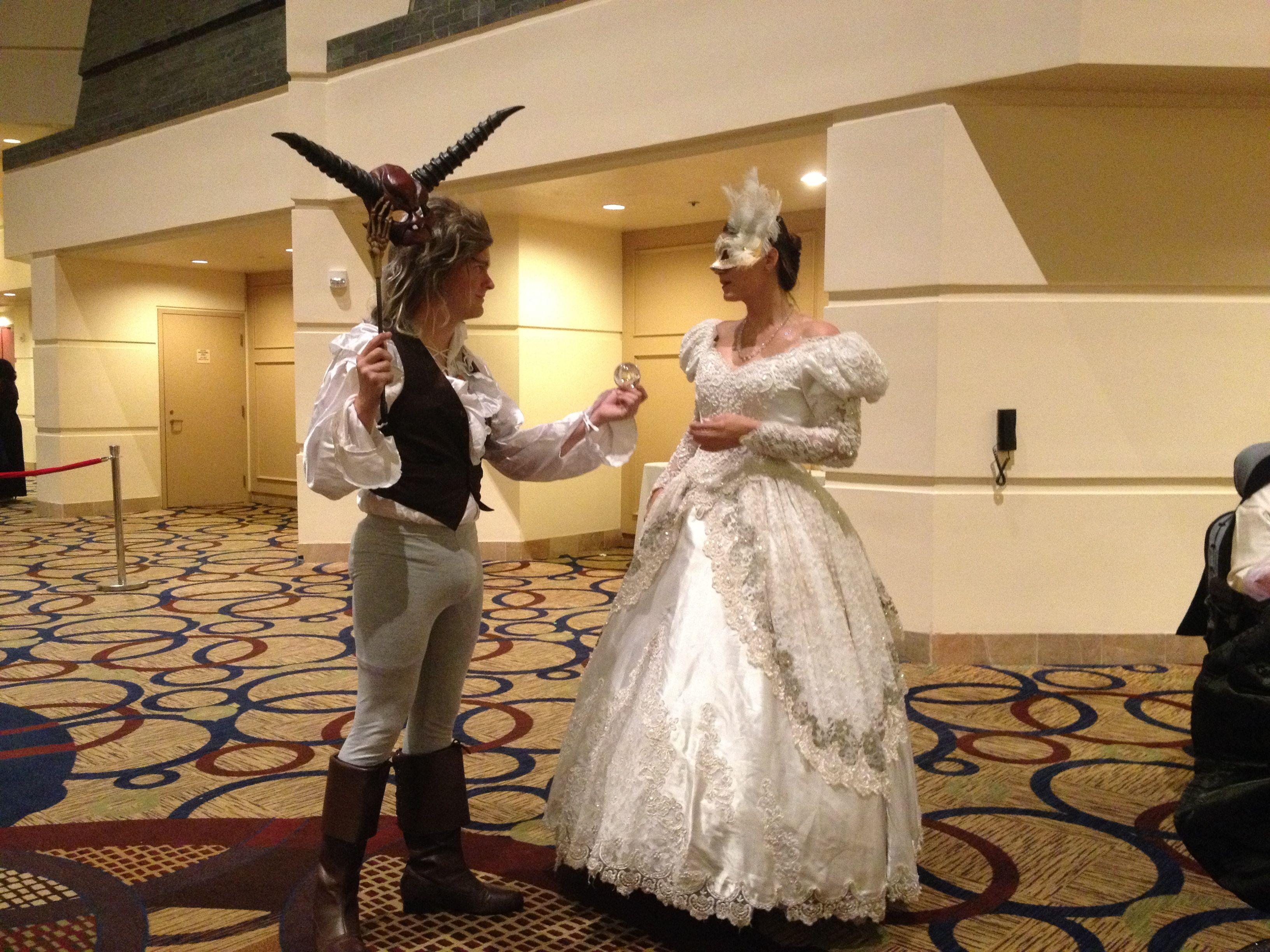 Two attendees dressed in full ball regalia for Goblin Ball