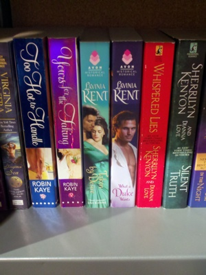 Close up of Kent title spines. The image is really HUGE compared to the neighboring book spines.