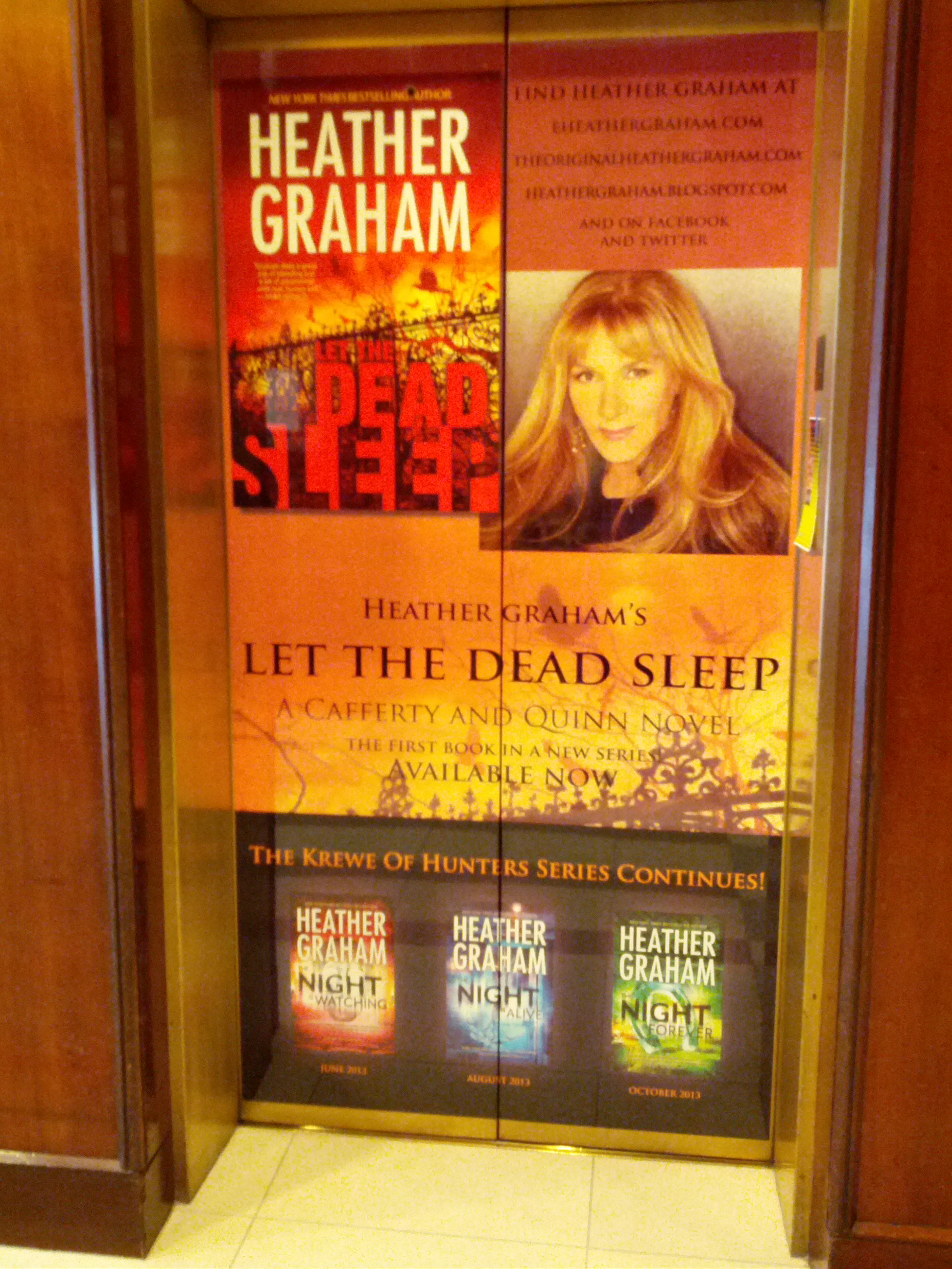 Elevator doors branded with Heather Graham image and books
