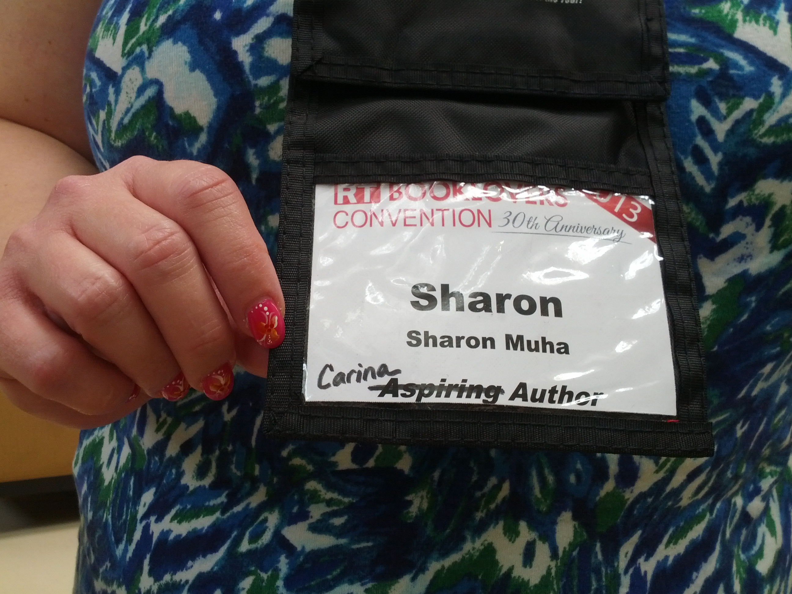 Sharon Muha's badge, with aspiring author crossed off in favor of Carina author.