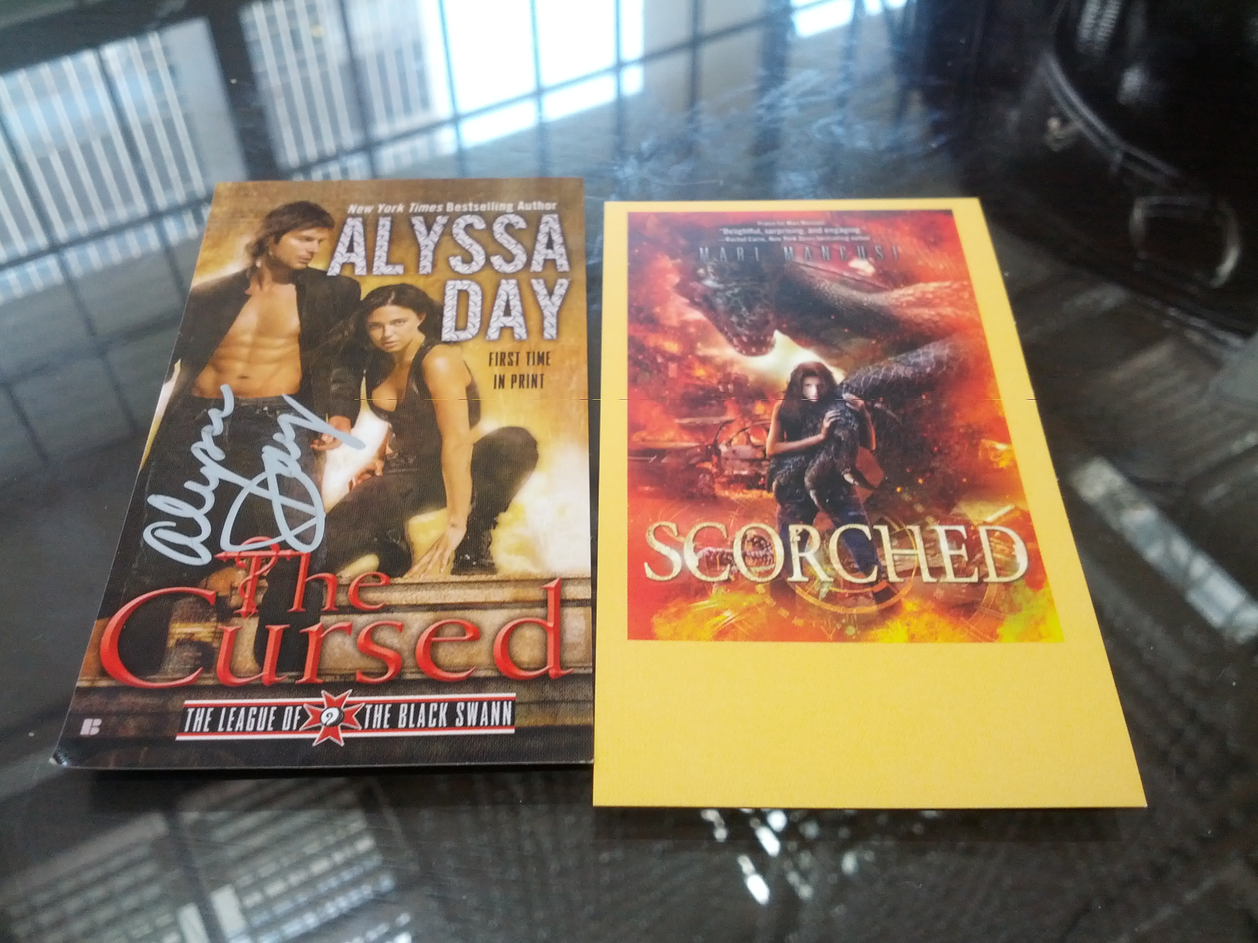 Stickers for ereaders showing Mari Mancusi and Alyssa Day's book covers