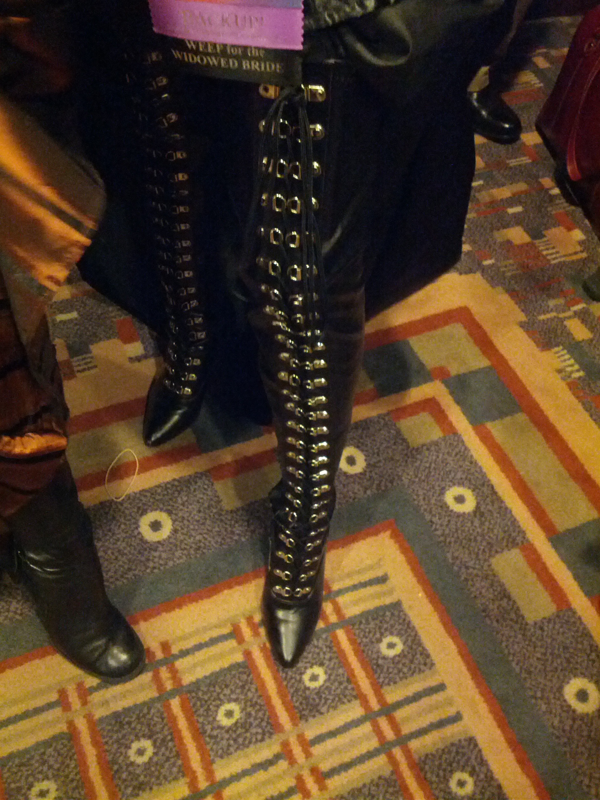Close up of mega awesome boots with metal laces up the front