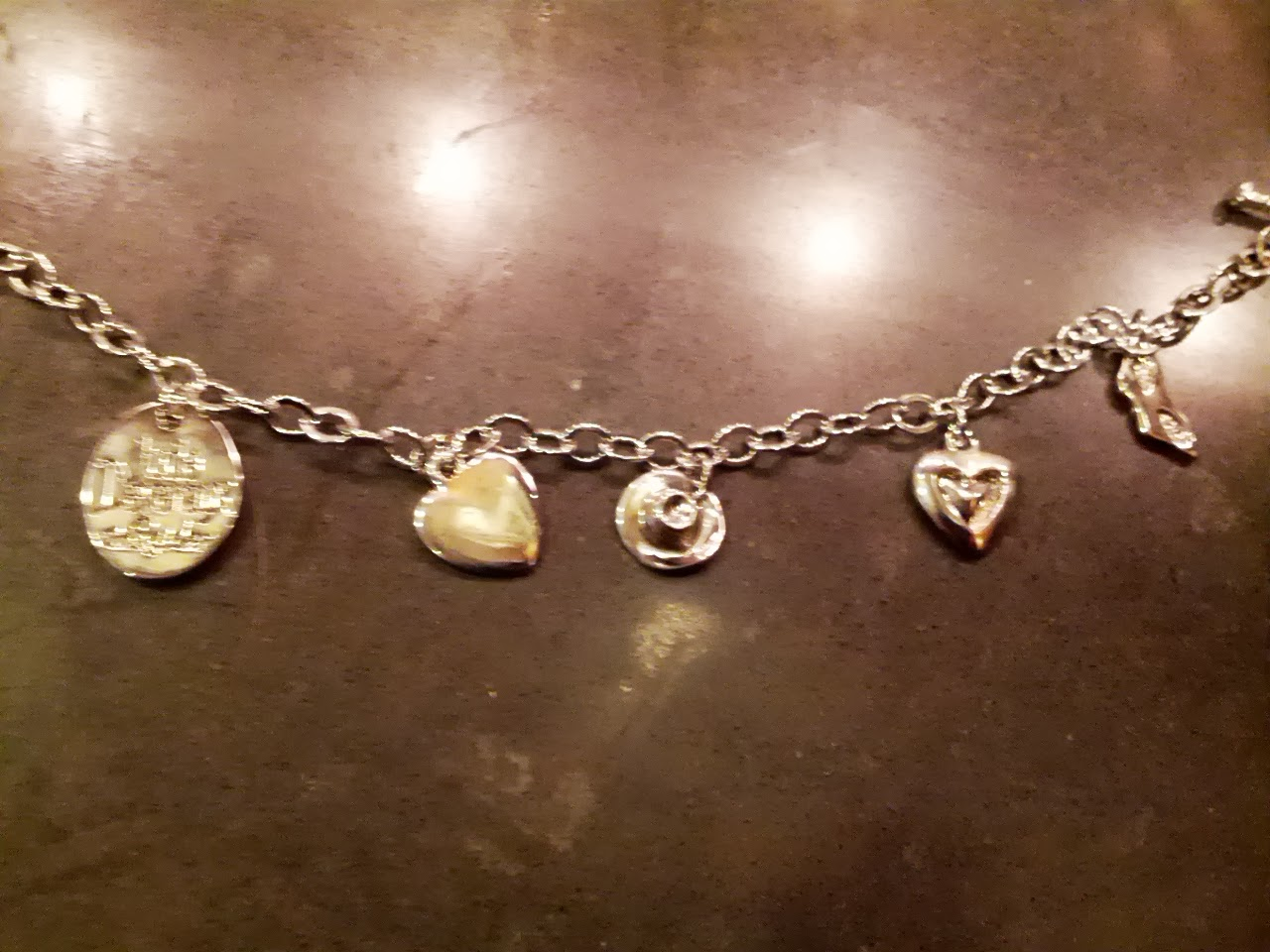A blurry pic of the charm bracelet