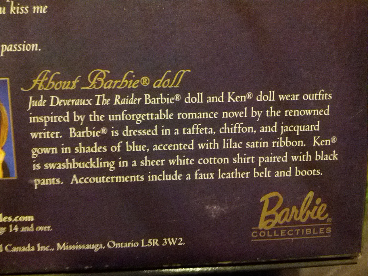 The description reassures the reader that the Barbie is dressed in taffeta, chiffon and jacquard, while Ken is swashbuckling in a sheer white cottong shirt. There are also accouterments.