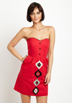 red strapless dress with very vag-looking ovals down the front below the waist.