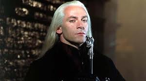 Lucius Malfoy from the Harry Potter movies long white hair condescending sneer metal topped cane