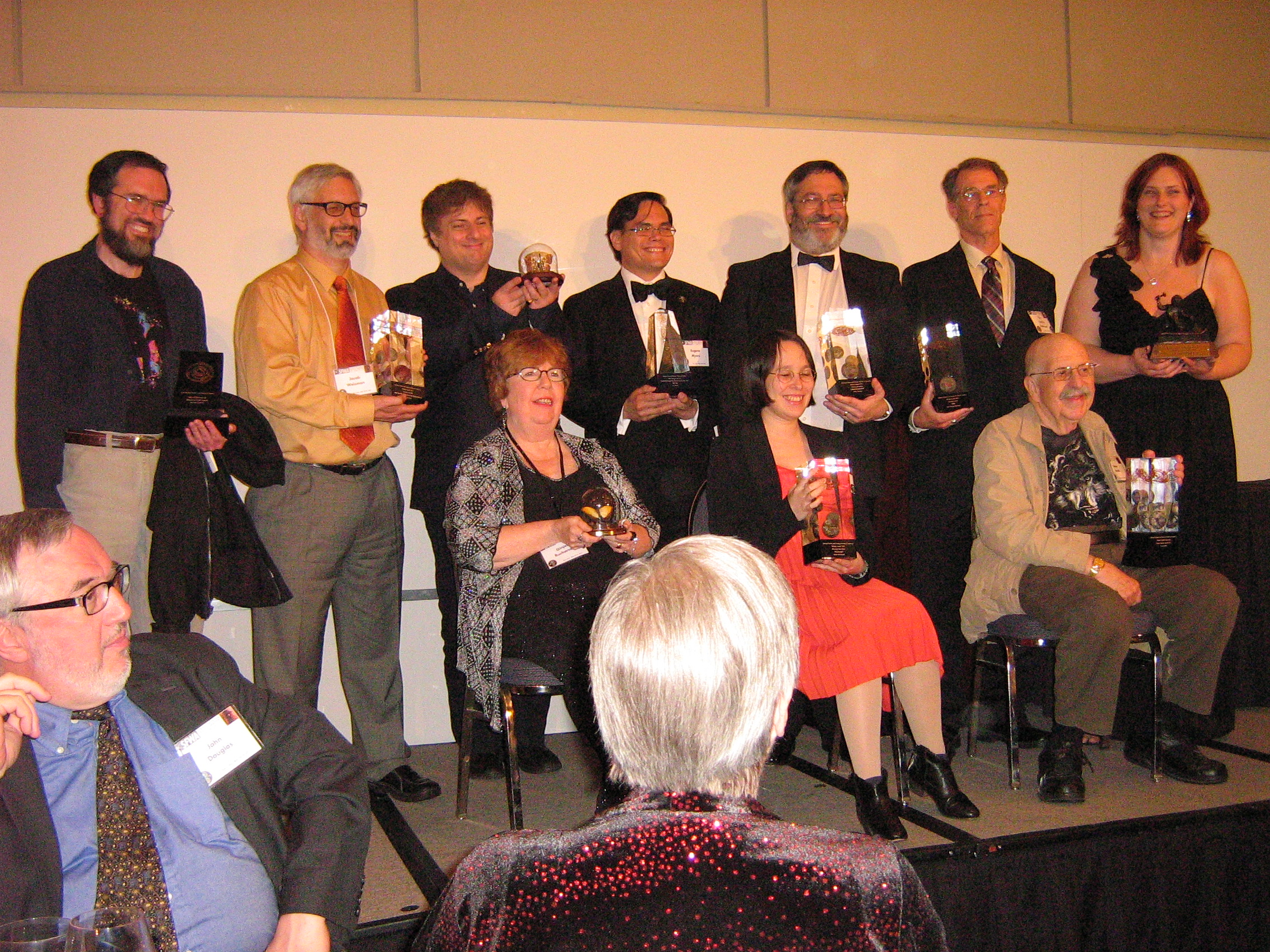 Nebula Award Winners holding awards - photo by Carrie S