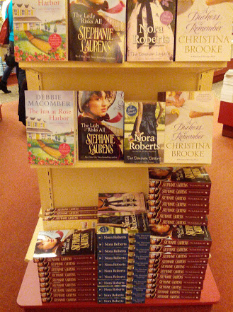 Stephanie Laurens and other authors on an end-cap shelf display.