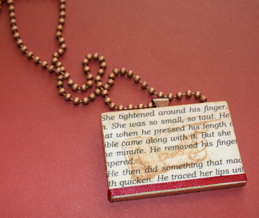 Romance novel pendant with sex scene pasted on front