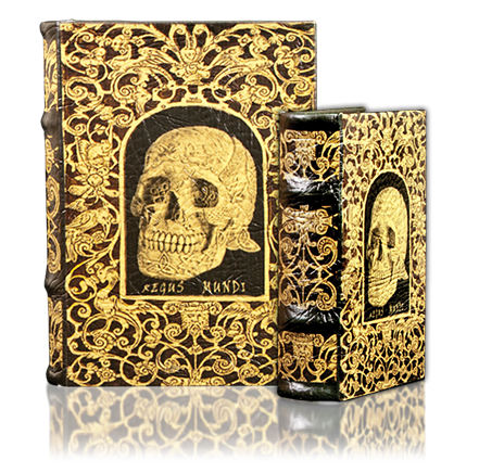 Book Box: a box shaped to look like an antique book, with synthetic leather covers and felt lined interiors. This picture has scrollwork and a skull on it.