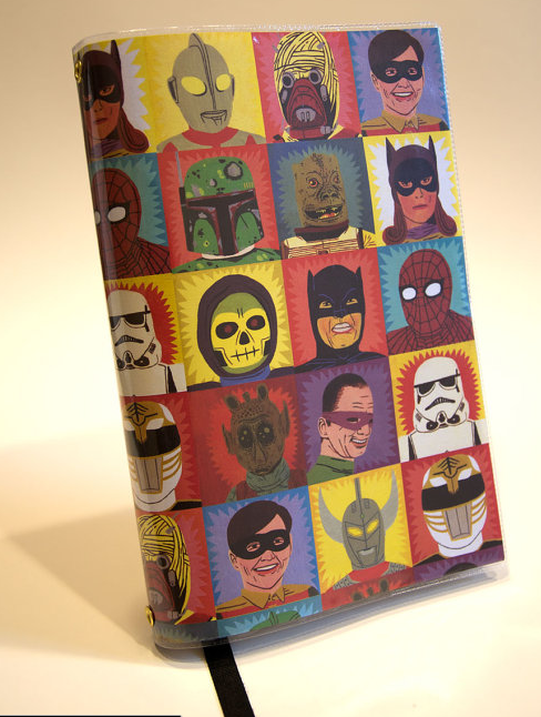 Hide-a-Book fabric book cover, with hero and villain cartoon faces in colorful squares on it - it's really cute.