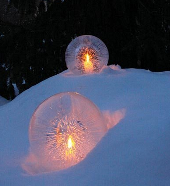 Globes made of ice with tea lights inside