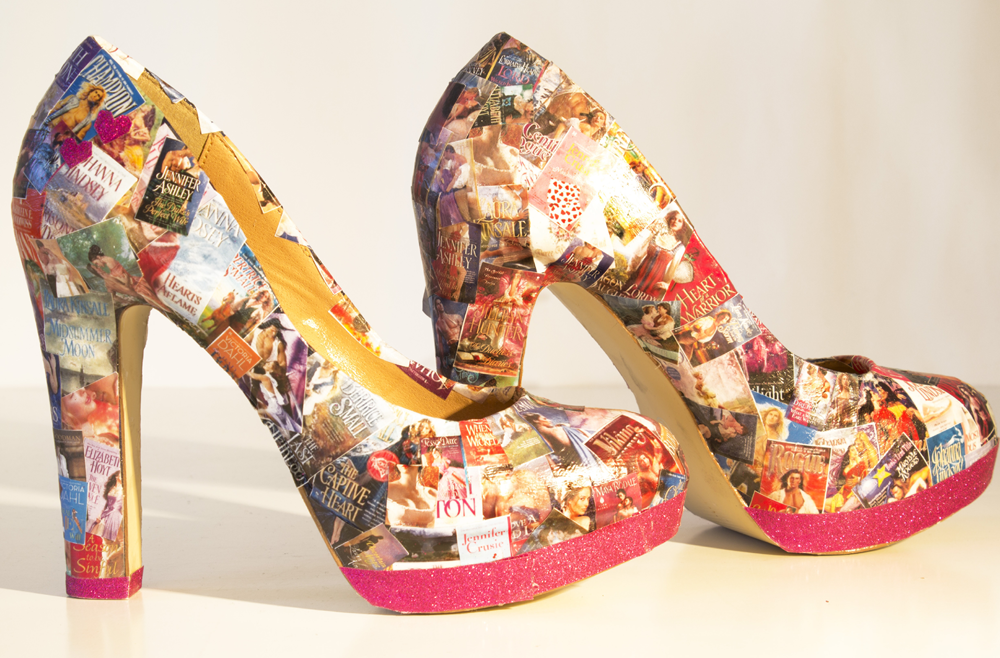A platform heel with decoupage miniature romance covers glued all over it.