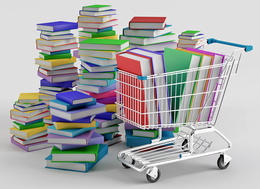 Stacks of books and a shopping cart - image courtesy of BigStock.