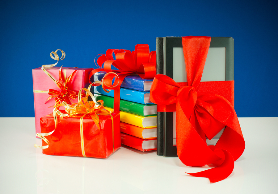Ribbon wrapped books, presents, and digital readers against a blue background.