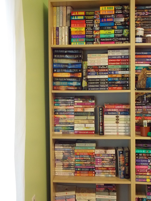 Elyse's Nora Roberts bookshelf: every book NR published. Every single one.
