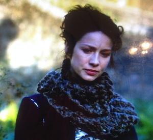 Claire's cowl, a chunky knit large swath of dark yard around her neck twice