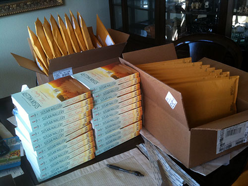 Review Crew mailing - piles and piles of books and mailing envelopes
