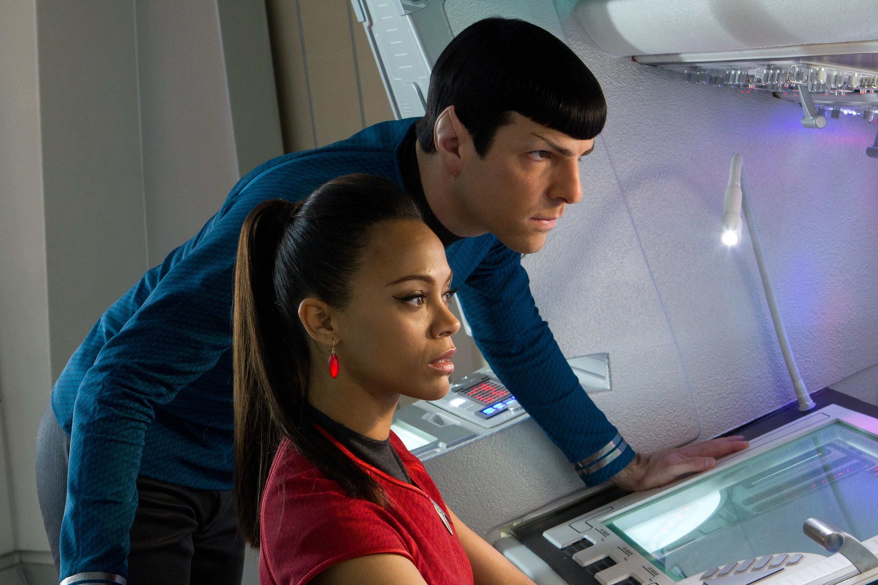 Spock leaning over Uhura's shoulder at her desk