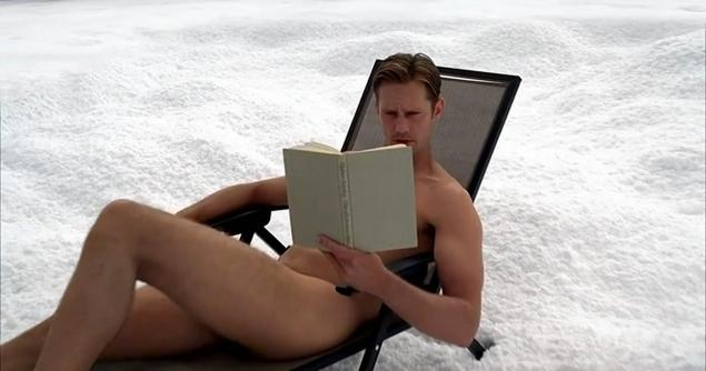 Alexander Skarsgard naked in the snow reading a book